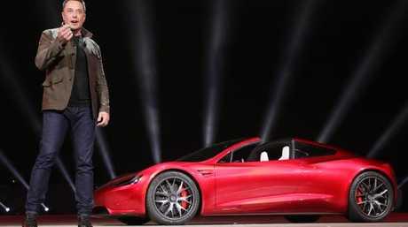 Tesla boss Elon Musk with the Roadster.