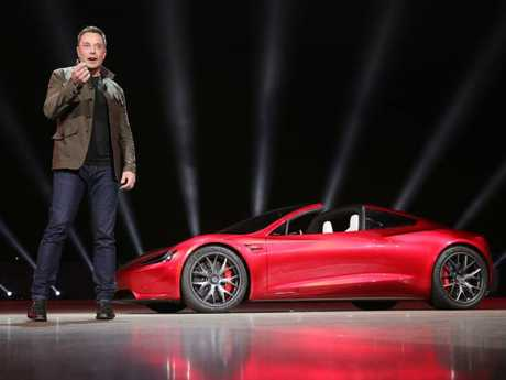 Tesla boss Elon Musk with the Roadster.