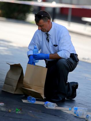 Officer gathers evidence. Pictures:John Grainger