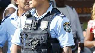 Police at the scene in Bankstown shortly after the murder. Picture: David Swift.