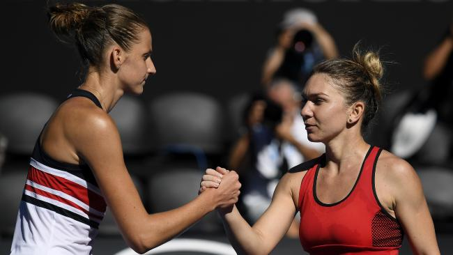 Karolina Pliskova congratulates Simona Halep at the Australian Open.