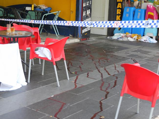 A trail of blood is left at the cafe where Mr Ledinh was killed. Picture: John Grainger