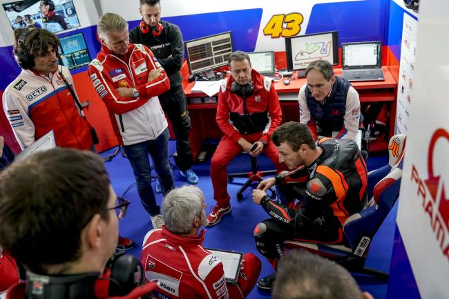 Pramac and factory Ducati engineers listen to Miller's feedback during testing. Pic: Pramac