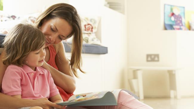 Mother caring for a child, taking care of her child mother and children, childcare, parents, stay at home mum, mother, bond between mother and child, generic, thinkstock, motherly love, working mother, woman reading with kid on her lap, reading to her child