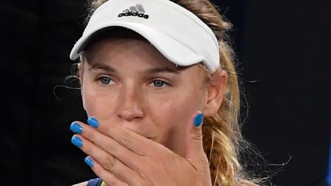Denmark's Caroline Wozniacki celebrates beating Spain's Carla Suarez Navarro