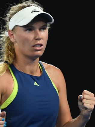 Caroline Wozniacki of Denmark celebrates her win.