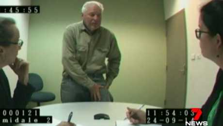 Schwarz is questioned by police during the lengthy investigation.
