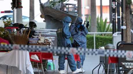 Forensic officers at the murder scene yesterday. Picture: David Swift.