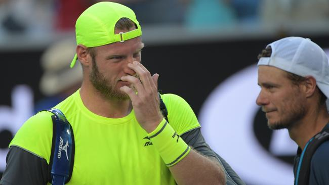 Sam Groth wipes away a tear after farewelling the Australian Open crowd.