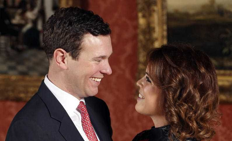 Britain's Princess Eugenie and Jack Brooksbank pose for the media in the Picture Gallery at Buckingham Palace after they announced their engagement in London