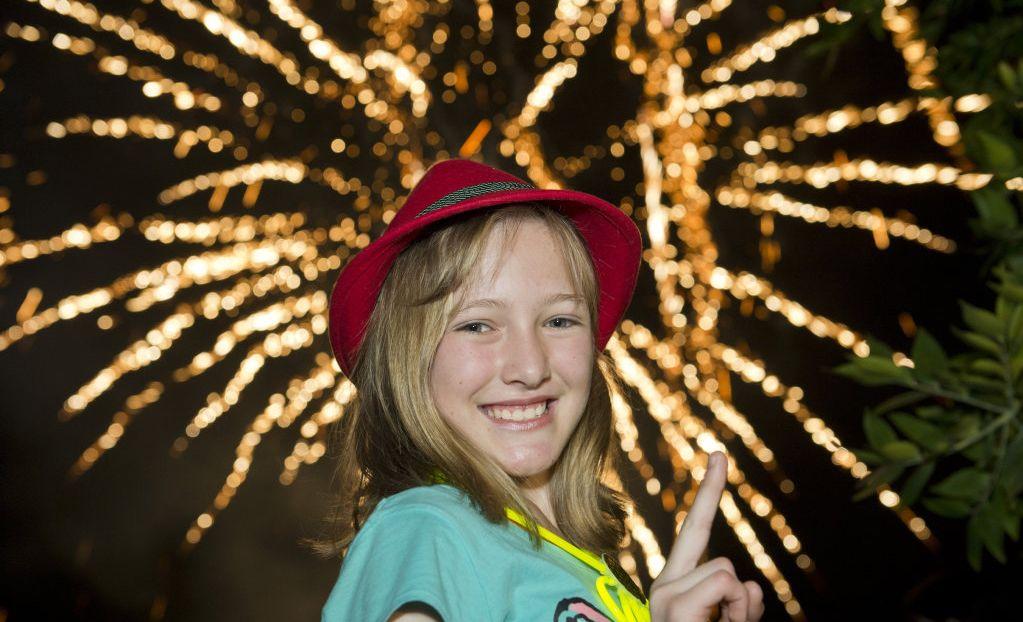 Daneisha de la Guerra enjoys the fireworks display as part of New Year's Eve celebrations in Queens Park, Saturday, December 31, 2016.