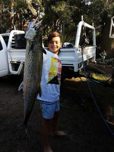 Jayden Mathews and a mackerel he caught.