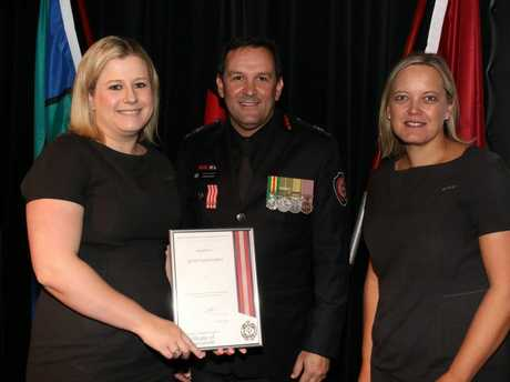 At the awards ceremony are (from left) Quest Toowoomba front office manager Angela Fowler, QFES Assistant Commissioner Stephen Smith and general manager Cynthia Rice.