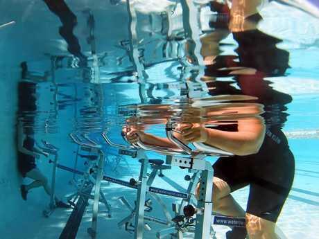 Anita Swan at Star Swim runs a fitness business using bikes under the water.