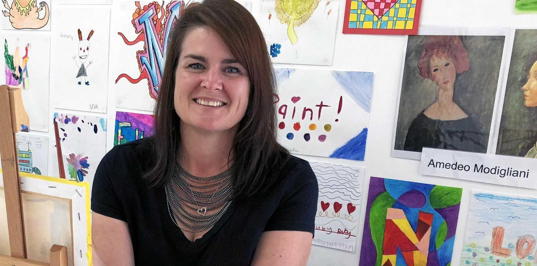 NEW STUDIO: Art teacher Nikki Harris surrounded by student artwork in her Open Your Art studio.