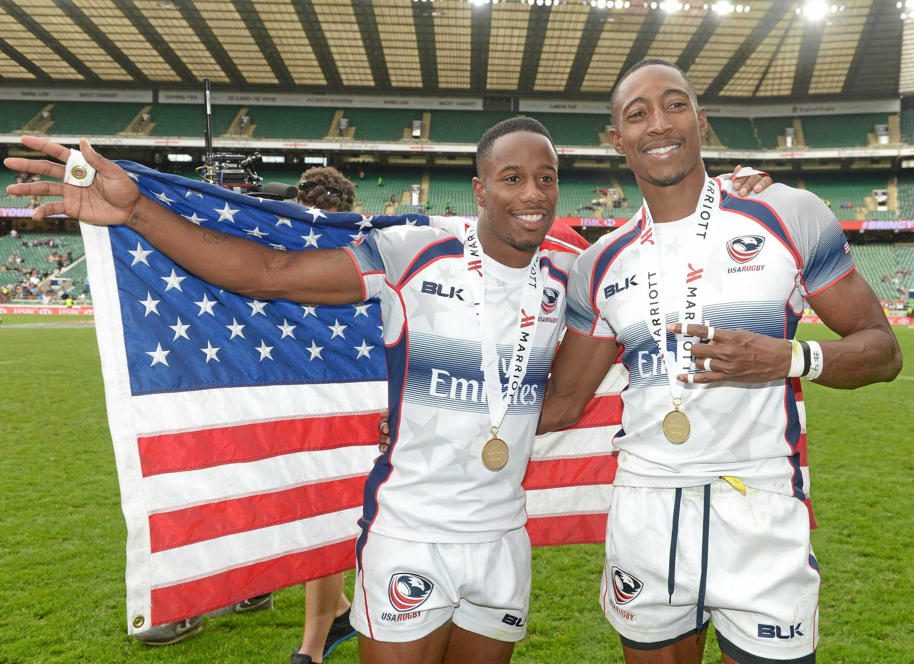 United States of America's Carlin Isles (left) and Perry Baker (right) who are also members of the USA Olympic Sprint team celebrate winning the London Sevens rugby tournament at Twickenham Stadium, London, Sunday May 17, 2015.  USA beat Australia 45-22 in the Cup final of the Marriott London Sevens to lift their first-ever Cup title. (Adam Davy / PA via AP) UNITED KINGDOM OUT - NO SALES - NO ARCHIVES