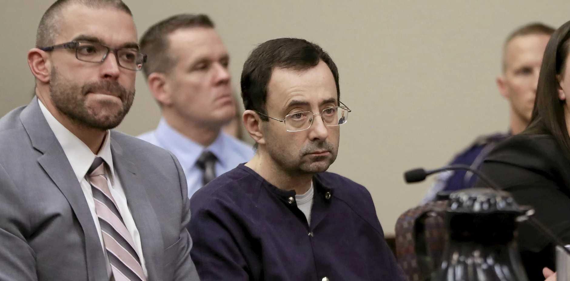 Larry Nassar, right, sits with attorney Matt Newburg during his sentencing.