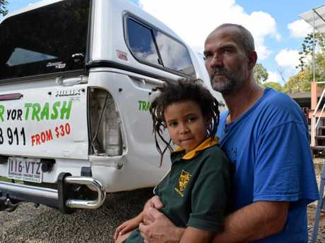 Yandina man Tom Matyas and his daughter Ester survey damage to Mr Matyas' four-wheel-drive he says occurred in a road rage incident.