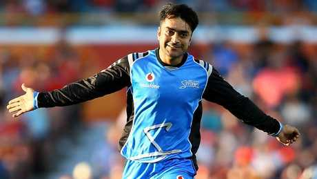 Rashid Khan of the Strikers celebrates the wicket of Ashton Turner.