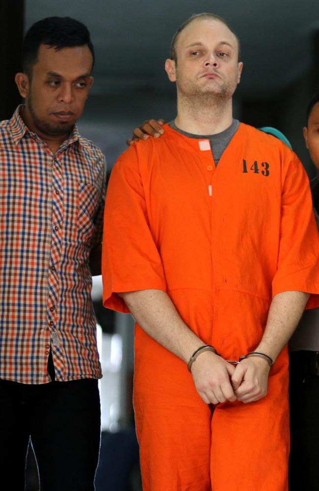 Australian accountant, Isaac Roberts in handcuffs. Picture: Lukman S. Bintoro / News Corp Australia