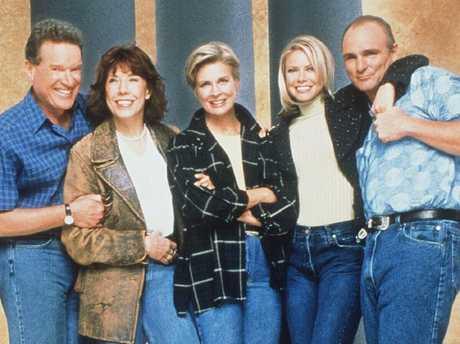 Candice Bergen (c) and the cast of TV program Murphy Brown.