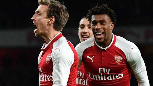 Arsenal's Spanish defender Nacho Monreal (L) celebrates.