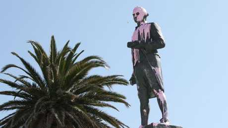 Pink paint is seen covering the head of the James Cook statue in St Kilda yesterday.