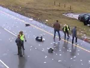Crash sends money raining over highway
