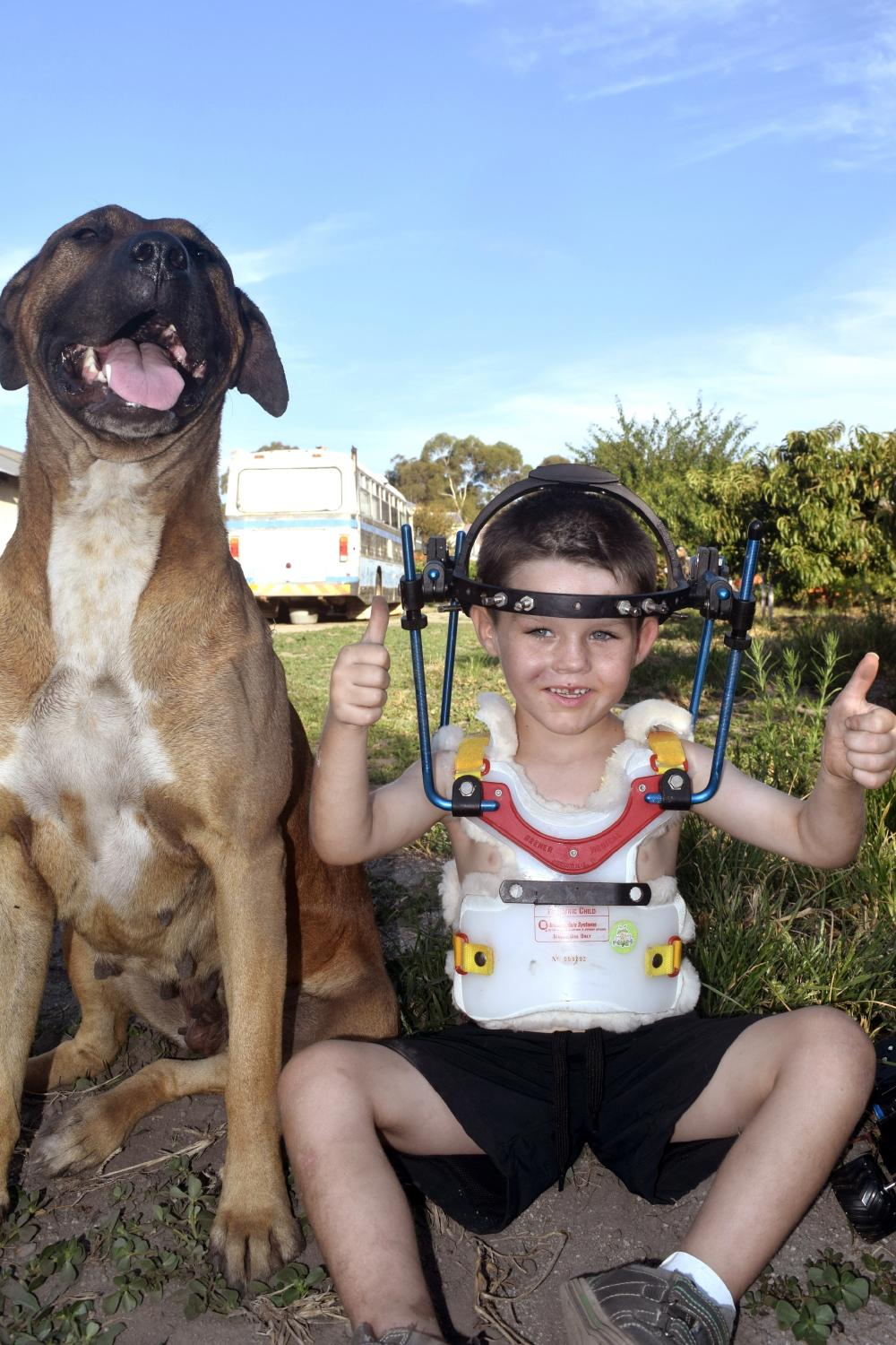 Miracle shotgun survivor Cameron Calvisi, 5, is loving being back home with his toys and puppy pal Buddy.
