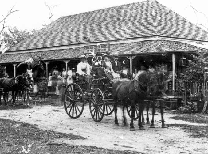 The Coochin Creek Hotel, Beerwah, in 1895, with owner John Simpson driving the buggy. Built in 1880s as a hotel, store and guest house, it was a stopping place for Cobb & Co coaches.