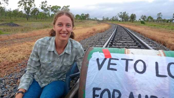 Claire Ogden protesting on a rail line outside of Bowen on Thursday morning.