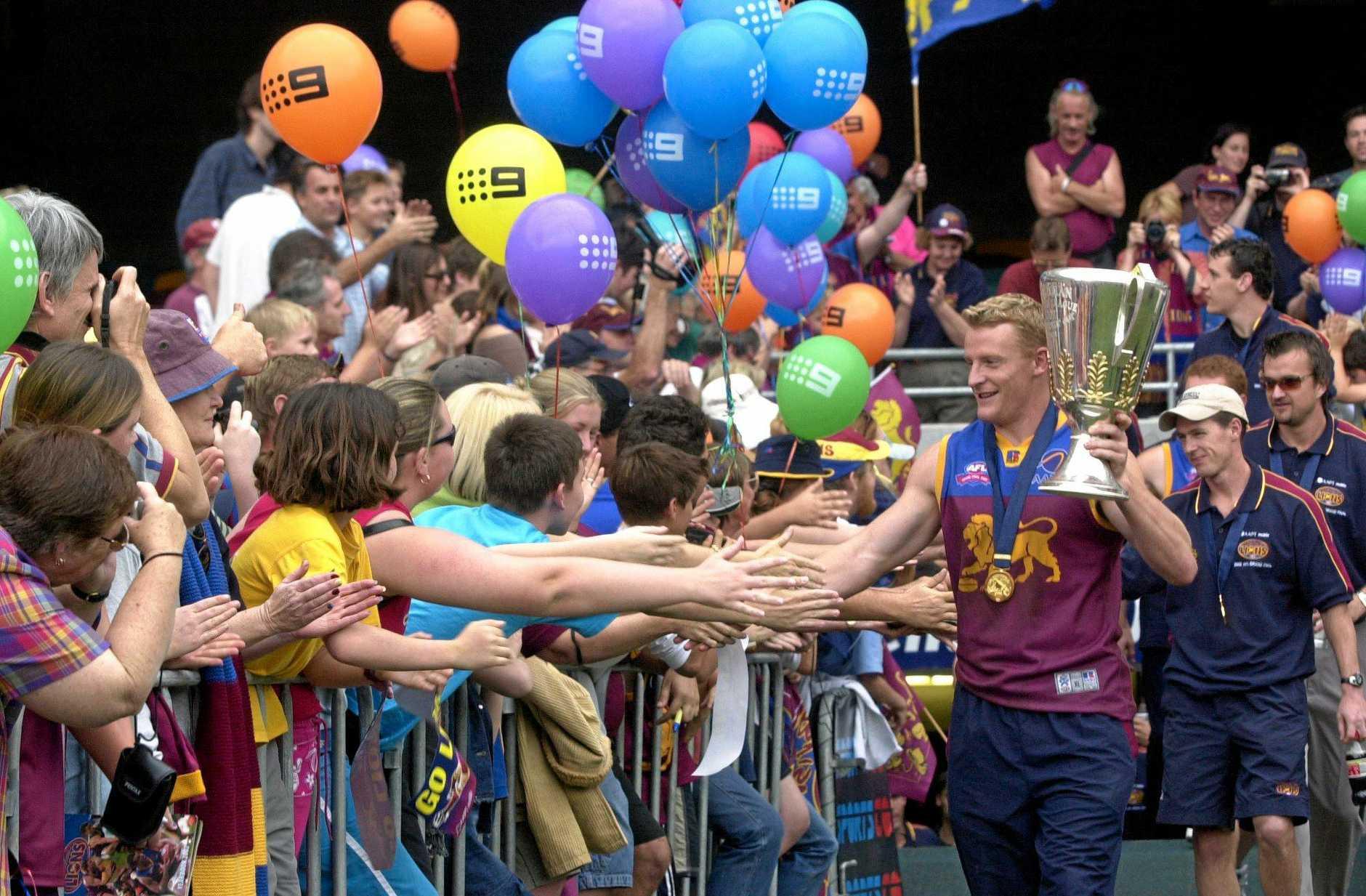 Fans flock to celebrate the Brisbane Lions 2002 premiership success.