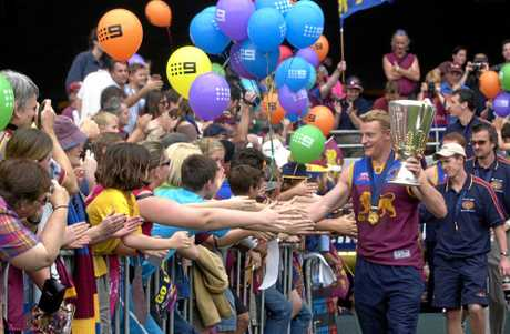 Fans flock to celebrate the Brisbane Lions 2002 premiership success.