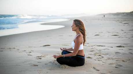 Kat Harding enjoys the serenity of a local beach.
