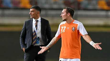 Roar player Eric Bautheac and coach John Aloisi watch on during the game against Ceres Negros.
