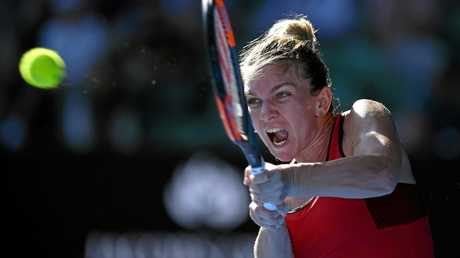 Simona Halep hammers a backhand return in her semi-final win over Angelique Kerber.