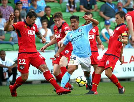 Melbourne's Daniel Arzani cuts his way through the Adelaide United defence.