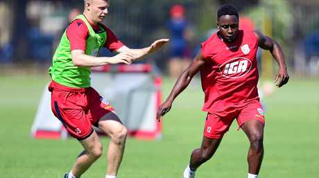 Jordan Elsey (left) and Mark Ochieng compete at training.