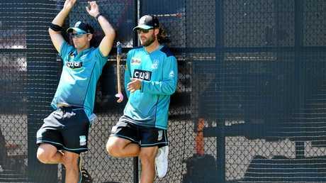 Brisbane Heat coach Daniel Vettori (right) and assistant Shane Bond watch on at training.