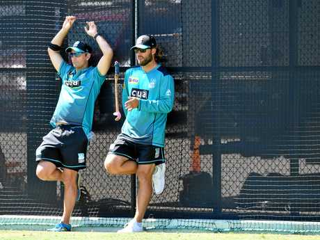 Brisbane Heat coach Daniel Vettori (right) and assistant Shane Bond watch on at training.