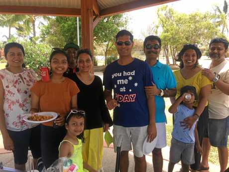 Ram Dammalapati, in bright blue, celebrating Australia Day with his friends and family at the park at Mackay Harbour, which has become a tradition since moving here.