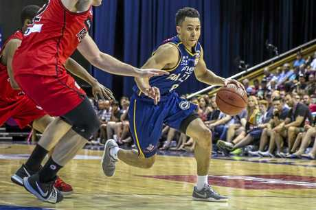 Travis Trice drives the ball down court for the Bullets.