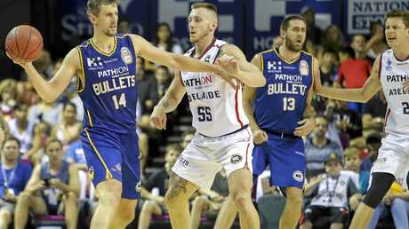Daniel Kickert (left) of the Bullets comes up against 36ers rival Mitch Creek in round 13.