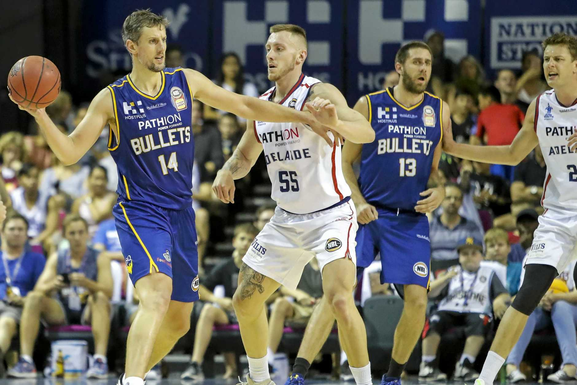 Daniel Kickert (left) of the Bullets is guarded by Mitchell Creek of the 36ers during the round 13 NBL match between the Brisbane Bullets and the Adelaide 36ers at the Brisbane Convention and Exhibition Centre, Brisbane, Sunday, January 7, 2018. (AAP Image/Glenn Hunt) NO ARCHIVING, EDITORIAL USE ONLY