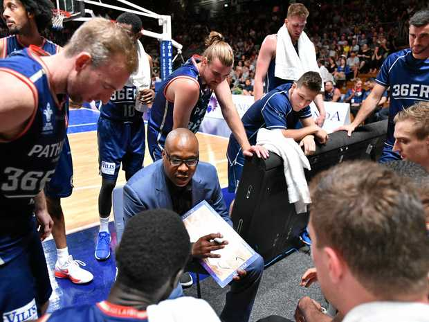Joey Wright talks to his players during a break in play.