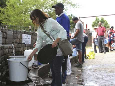 People queue to collect water from a natural spring in Cape Town, South Africa, Monday, January 22, 2018 as the city suffers from one of the worst droughts in recent history. Picture: Anwa Essop