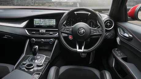 Giulia cockpit: Sporty wheel, leather trim and upgraded (if fiddly) infotainment.