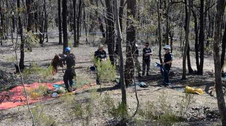 Police at Kangaroo Flat where the body of Simone Quinlan was found down a mine shaft. Picture Daryl Pinder