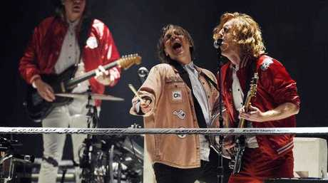Left to right, Win Butler, William Butler and Richard Reed Parry of Arcade Fire perform during the band's concert at The Forum on Friday, Oct. 20, 2017, in Inglewood, Calif.