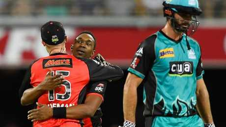 Dwayne Bravo sees off Ben Cutting. (Photo by Ian Hitchcock/Getty Images)